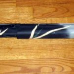 An after picture of a duracoated Remington 870 shotgun