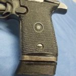 A closeup on our S&W Star pistol's grip before disassembling for cleaning and duracoating